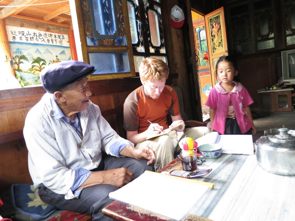 Interview with an 85 year old Cizhong villager who learned to make wine from French Catholics in the 1930s (photo by Sun Fei).