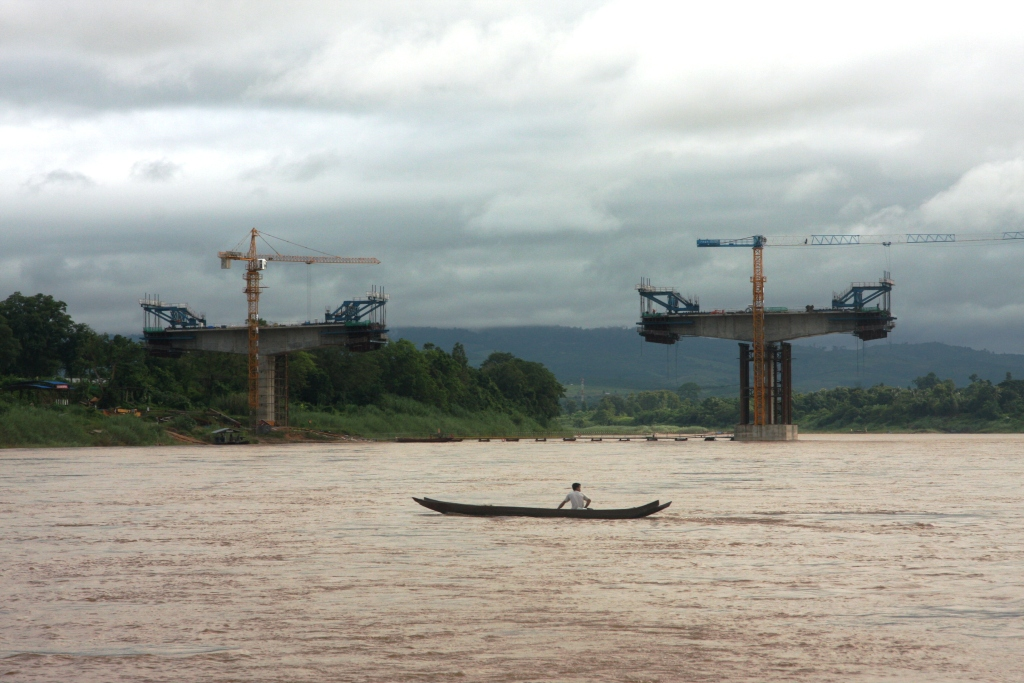 A local fisherman navigates the Mekong downstream of the new bridge (July 2012)
