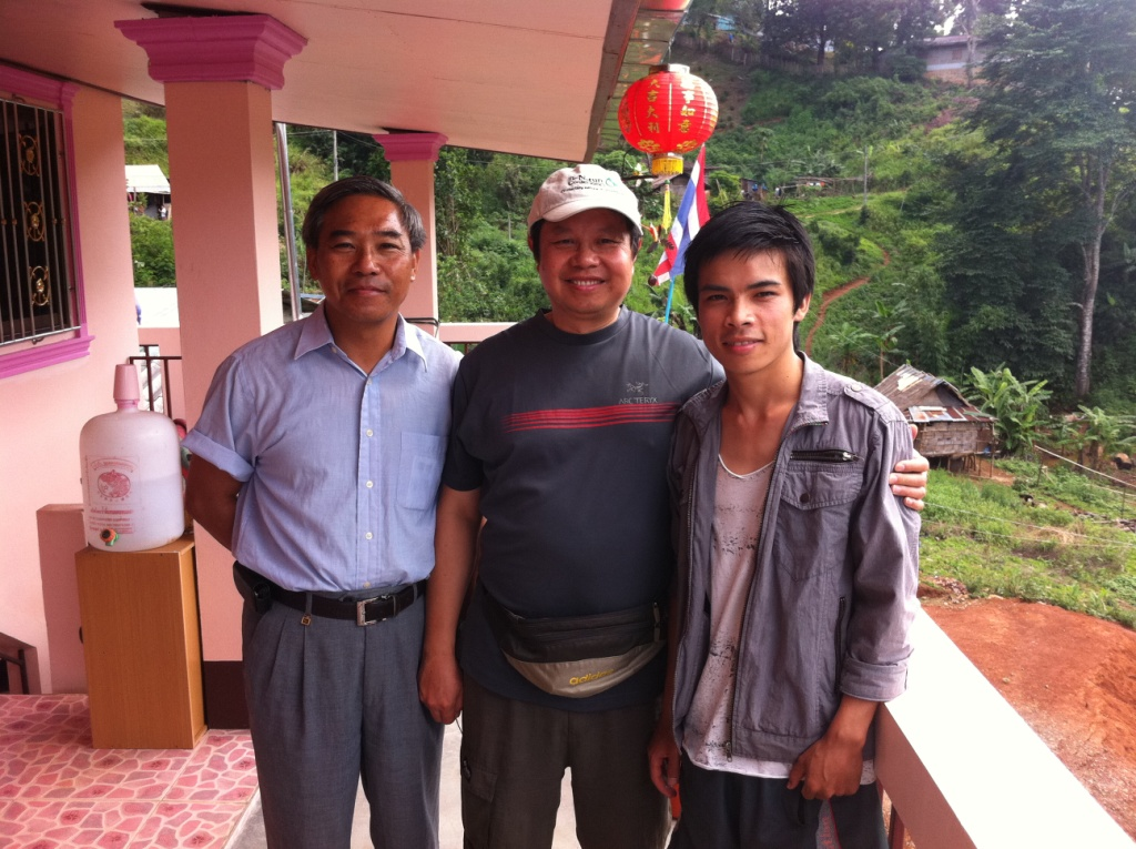 (from left) Pastor Yang with ExSE contributor Zhou Dequn and Ashi, the first of his family to attend college after matriculating through Yang's school