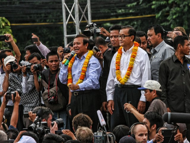 Sam Rainsy arrives at a peaceful CNRP rally in Cambodia in August 2013.  Courtesy Corbis Images.