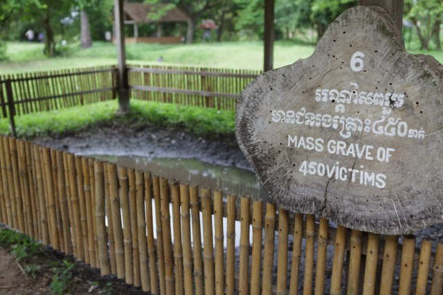 A mass grave of the victims of the Khmer Rouge, The Killing Fields at Choeung Ek, Cambodia.  Courtesy Corbis Images