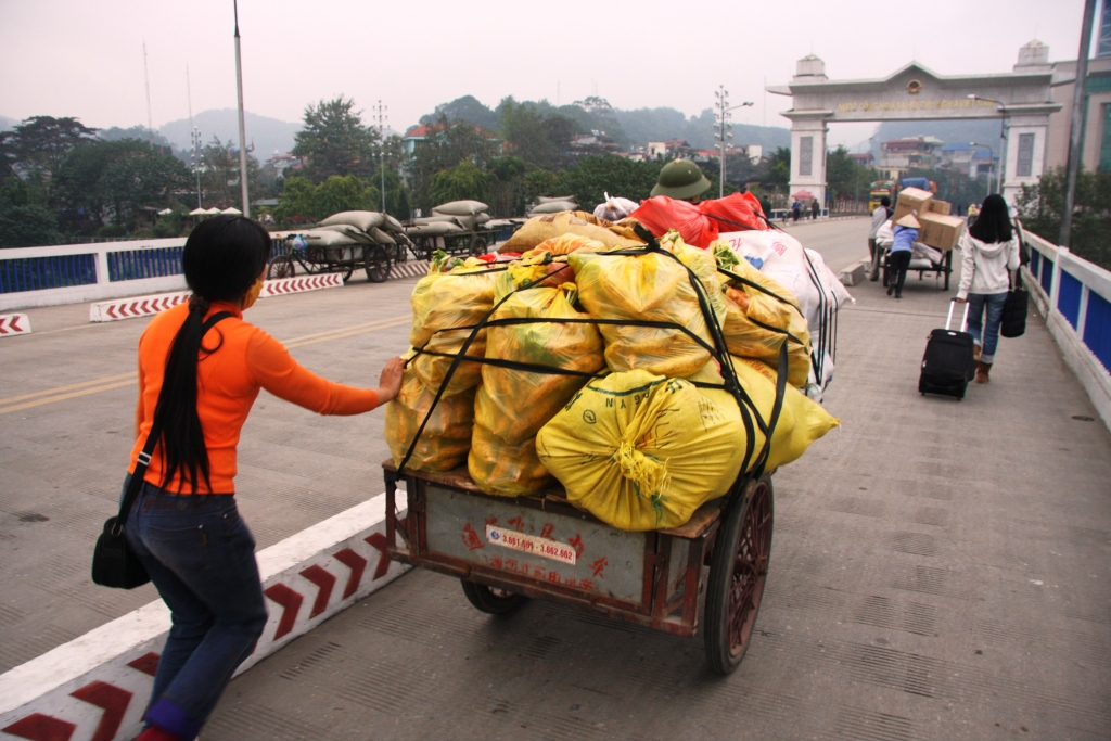 A local trader crosses from China into Vietnam at the Hekou-Lao Cai border crossing.  The last decade has seen a huge increase in border trade between China and Vietnam.