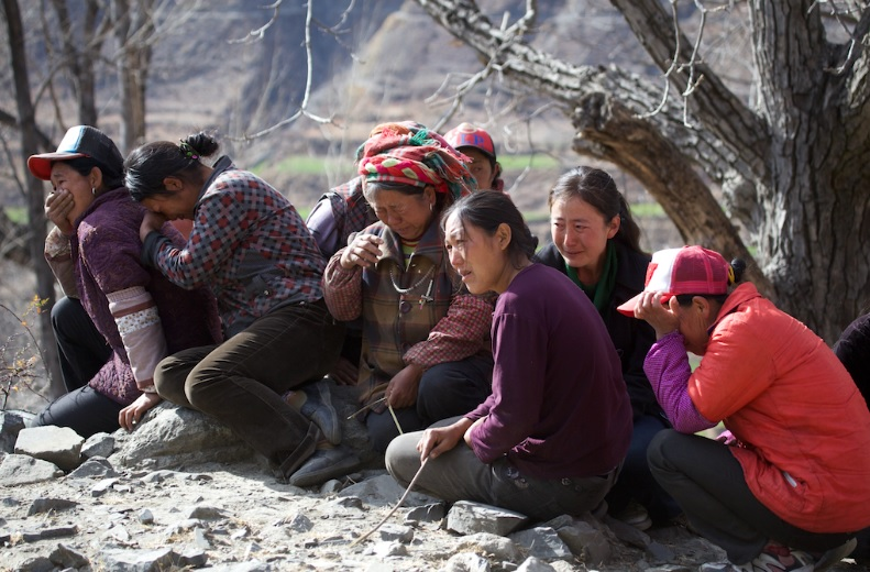 Shangpu villagers weeping uncontrollably at the thought of relocation
