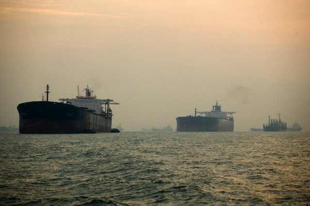 Cargo ships docked offshore in the Strait of Malacca