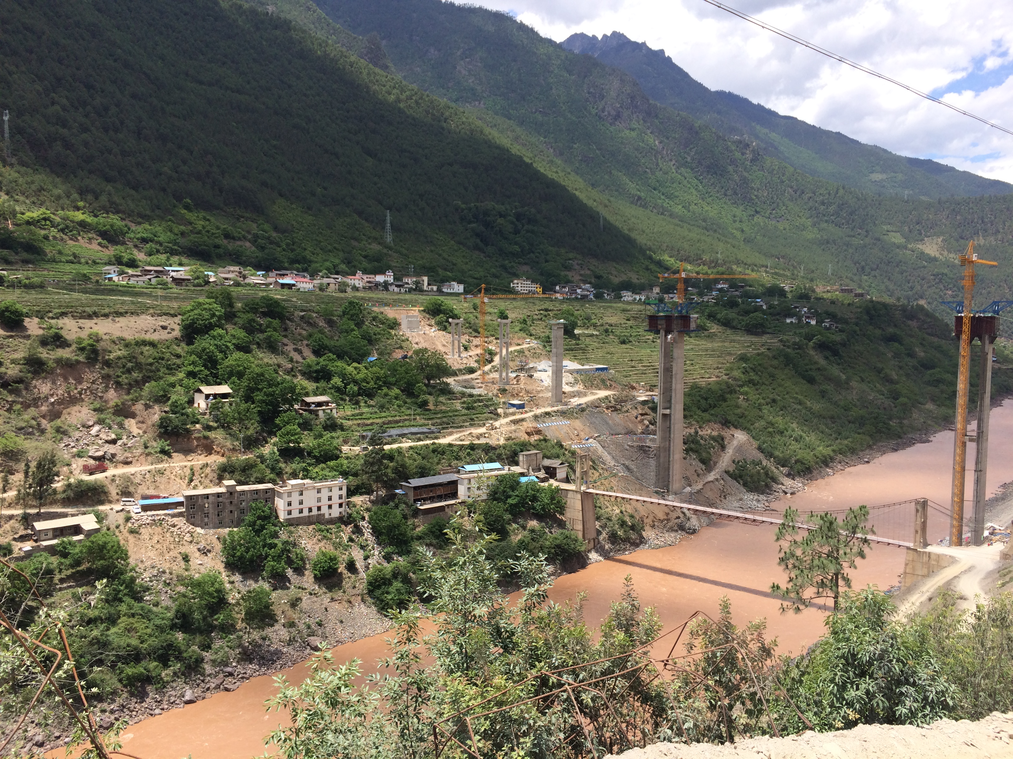 List of major power stations in yunnan - Cizhong Village In The Background Along The West Bank Of The Upper Mekong In Yunnan