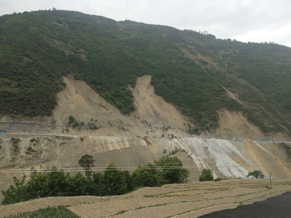 Highway construction opposite Cizhong has led to landslides and more than 50 deaths.