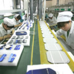 Solar powered photovoltaic cells are assembled by workers at a factory in Dezhou, Shandong province (Image: ​Greenpeace/Alex Hofford)