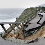 """The southbound lane of Highway 1 is shown after sliding down the hillside on Wednesday, March 16, 2011 in Big Sur, Calif. Authorities say that the closure came after 40-foot stretch of the highway slid down a hillside shortly after 5 p.m.  in an area called Hurricane Point following several days of heavy rains. The Monterey Times Herald reports that CHP said the highway could be closed """"potentially several days if not longer. No injuries were reported. (AP Photo/Monterey Herald, Orville Myers)"""